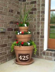 Cool idea!  Planter with house number.