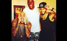 Swizz Beats hangs out with Magic Johnson, and Chris Brown in cannes.