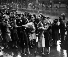 Women dancing in the street to celebrate the end of war