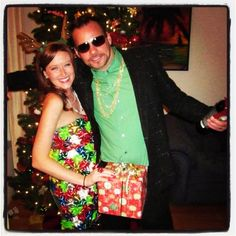 Dick in a box + bow dress = best dressed winners at the ugly sweater party