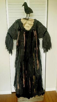 Witches Dress, this costume is a custom ripped rag witches dream dress. Made with a mix of interesting fabrics, all hand stitched together to create this hauntingly spooky dress.