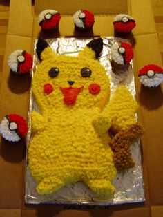 "Pikachu cake. This was my first decorated cake.  It was for my son's 4th birthday.  It is a combination of white and chocolate cakes with buttercream icing.  I used  a star tip to decorate it .  My son liked the poke' ball cupcakes better than the cake.  He kept trying to open the ball by pressing the ""button"" on top."