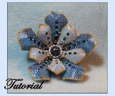 Flower Pearl Beaded Brooch Pattern by Paula Adams AKA Visions by Paula at Bead-Patterns.com! Lots of FREE beading patterns and tutorials are available from various designers!