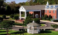 Groupon - Two-Night Stay at Colonial Crossings Of Williamsburg in Williamsburg, VA in Williamsburg, Virginia. Groupon deal price: $149.00