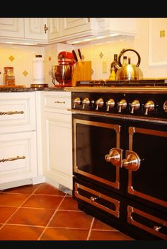 Saltillo Tile Kitchen White Cabinets