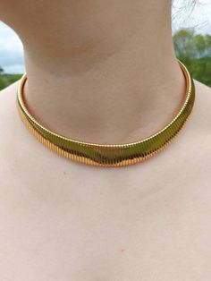 Vintage Monet Snake Chain Necklace, 1980s Collar Necklace, Gold tone Necklace, Signed.  Excellent vintage condition, with minimal signs of wear, as seen in photos.  Signed with Monet copyright stamp.  *We aim to sell items in the best possible condition, however most of our stock is vintage and therefore secondhand and may have some signs of wear. Any major flaws will be noted in description and highlighted in photos to the best of our ability*