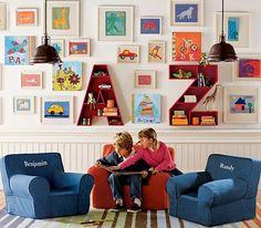 Cute A, Z bookshelves. Love the framed kids artwork as well.