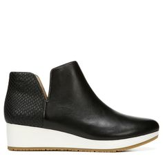 The Saraleah ankle boot from Dr. Scholls Original Collection puts a fresh take on a classic fall boot. A crisp midsole, luxe leather upper, and snakeskin details give this style a modern, on-trend feel, while a wedge heel and Memory Fit Foam insole will keep you comfortable no matter where the day takes you.