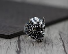 Silver Oni Ring, handcrafted from sterling silver and available at https://takumiarts.com Fine Japanese Jewelry from myths and legends : Dragon, Phoenix, Maneki Neko, Koi Carp, Sakura flowers, Youkai and much more. Handcrafted from sterling silver, pure silver and 18k gold. Free shipping and worry-free returns.