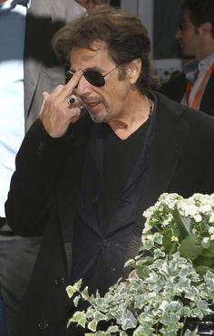 Al Pacino, actor/filmmaker. Well-known for roles as mobsters and criminals in crime stories. Some examples: Michael Corleone in The Godfather films, and Tony Montana in Scarface. He made other appearances in movies such as Serpico and Dog Day Afternoon.