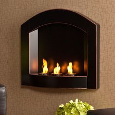 @Overstock - Enliven any space with this wall mount gel fuel fireplace. This piece is small enough to go anywhere and can be hung as easily as a picture. Finished in matte black with copper distressing, it works well with both contemporary and transitional styling.http://www.overstock.com/Home-Garden/Teva-Arch-Top-Wall-Mount-Fireplace/2682306/product.html?CID=214117 $159.99