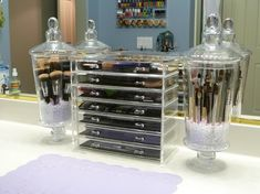 Dust Free Makeup Brush storage. I would find similar containers small enough put on a spice rack (to get things off of the counter) and store them with my other makeup and cleansers.