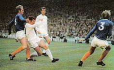 22nd August 1970. Johnny Giles and Paul Madeley working their away around Everton duo Sandy Brown and Keith Newton.