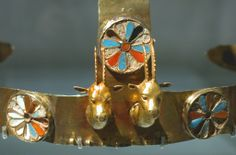 Close up of the diadem with two gazelle heads, gold, carnelian, turquoise and crizzed glass , excavated from the tomb of Menhet, Menwi, and Merti, three foreign wives of the pharoah Thutmose III (c.1475-1425BC). They were semitic princesses from the Levant, and each one held the title of King's wife. Despite the sumptuous jewelry discovered in their tomb, the absence of the vulture motif on their headdresses indicates they were only minor members of the royal harem.