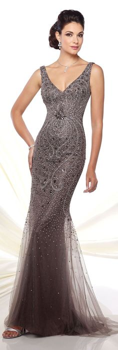 Gray evening gown with sheer and sequin embellishment detail.
