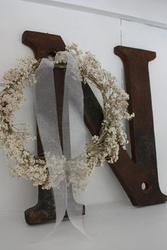 <3 small babys breath wreaths for pews.