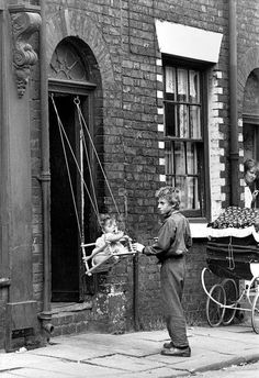 1960s, manchester. I remember these swings . ES - life without frills. How I imagine the slums to have been.
