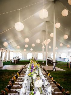 Hang up beauty on a budget with luminous paper lanterns inside an outdoor wedding tent.