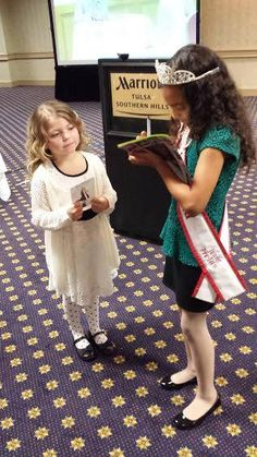 National American Miss Queen signs an autograph at a NAM Open Call!