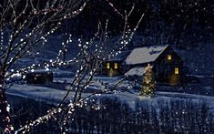 Snowy winter scene of a cabin in distance at night