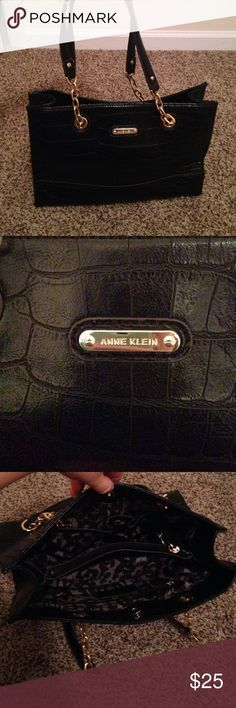 Perfect condition woman's purse Black leather like material with snake skin detail. Straps are the same with gold chain links. Inside is black and gray cheetah. Barely used and in perfect condition. No scuffs or stains. Plenty of space on inside with multiple storage compartments. Anne Klein Bags Shoulder Bags