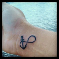 Brimming with symbolism and personal meaning, this Infinity Anchor tattoo combines 2 very iconic images in a very cool way. Believe it or not, we get photo submissions of tattoos to be used for custom photo urns and HeartFelt Keepsake® orders.