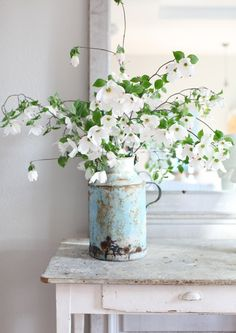 Dogwood blossoms were our wedding centerpieces. LOVE them!