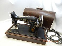 SINGER SEWING MACHINE! WITH CASE! VINTAGE 1927! SERIAL NUMBER AB914157! AS IS! THIS WOULD BE A GREAT RESTORATION PROJECT! A FANTASTIC SEWING GIFT! IT COULD EVEN BE SOMETHING THAT CAN BE USED A CONVERSATION PIECE IN THE LIVING ROOM!