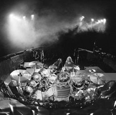 View looking from the back of the stage, looking out over drummer Neil Peart sitting at his drumkit with guitarist Alex Lifeson and bassist Geddy Lee on stage beyond at a concert by Canadian rock. Get premium, high resolution news photos at Getty Images Rock And Roll Bands, Rock Bands, Rock N Roll, Rhythm Method, Rush Concert, Rush Band, Geddy Lee, Neil Peart, Vintage Drums