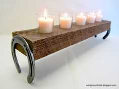 Put together a rustic candle holder from old horseshoes & reclaimed wood.