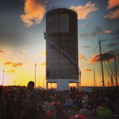 Outdoor movies - Silo Park, Auckland, New Zealand. Each Friday night in summer movies are projected onto this disused silo, accompanied by a food market, music, and stalls.