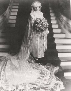 Bride Emily in her wedding gown on the steps of her family home, 1919, in Montgomery, Alabama. In 1950 the house became the Governor's Mansion.