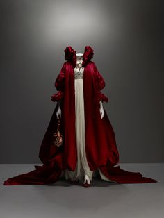 Alexander McQueen (British, 1969–2010) Ensemble The Girl Who Lived in the Tree, autumn/winter 2008–9 Coat of red silk satin; dress of ivory silk chiffon embroidered with crystal beads Courtesy of Alexander McQueen Photography by Sølve Sundsbø