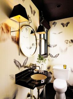 Black and gold themed bathroom with graphic wallpaper