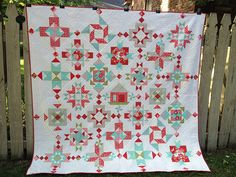Finished  red and turquoise quilt on-point by the messygoat from 2013