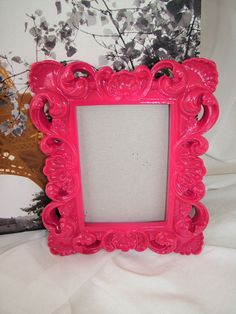 Spray paint thrift store picture frames bright colors for a funky look