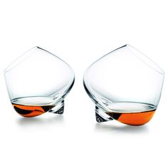 Cognac Brandy glasses // Normann Copenhagen. Designed to enhance bouquet, temperature and volume of the Cognac. When placed on a flat surface, the glasses gently revolve around their center before stopping still.