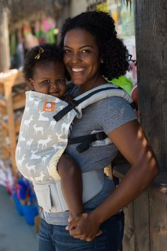 "Fawn displays silhouettes of baby deer on a light grey canvas, accented by stylish, geometric designs on the leg padding. Fawn has a stylish feel that will add a ""prance"" to your walk. Baby Tula's 'Fawn' baby carrier can be used in both front carry and back carry, and allows for babywearing from infants to toddlers."