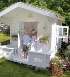 Beautiful playhouse with wallpaper inside