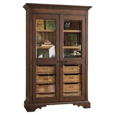 """Hayworth Pantry $1,476.95 Glass-door pantry with adjustable shelves and eight tray drawers.   Product: Pantry Construction Material: Poplar veneers, glass and hardwood solids Color: Distressed molasses Features: Part of the Paula Deen Home Collection Two doors Adjustable shelves Eight tray drawers Silverware insert Distressed finish Dimensions: 78"""" H x 50"""" W x 20"""" D"""