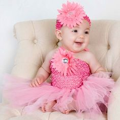 Turn your baby girl into a ballerina-style princess with this pretty pink floral tutu dress for baby girls. It has a large, soft daisy on the front of the dress and another attached to a trendy headband. It is made from comfortable stretch fabric.