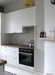 keittiö,keittiönkaapit,välitila,keltainen,keittiön välitila