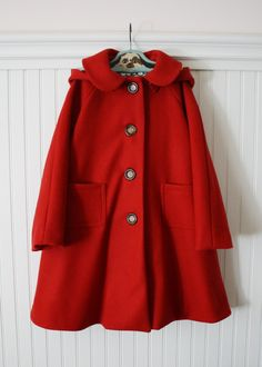 If I were a well-to-do grandma who wanted to spoil her granddaughter, I would buy this gorgeous Little Red Riding Hood coat, have her wear it when I took her to a Broadway show, and soak up the compliments on my great taste.