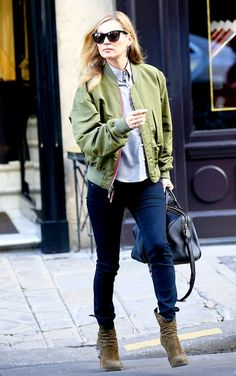 Kate Moss in a bomber jacket, button-down shirt and suede boots