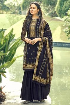 Exuding elegance and finished with perfection, this dusty black poly-cotton sharara suit which will certainly make you rule to the party. This closed neck and full sleeve costume is perfectly formed using digital print work. Set together with poly cotton sharara pants in dusty black color with dusty black poly-cotton dupatta. Sharara pant is plain. Dupatta embellished in digital print work. #trousersuit #salwarkameez #malaysia #Indianwear #Indiandresses #andaazfashion Indian Attire, Indian Wear, Sharara Suit, Salwar Kameez, Modest Wear, Trouser Suits, Indian Dresses, Asian Woman, Party Wear