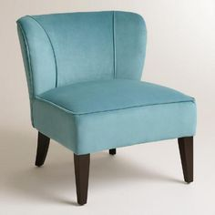 Our cosmopolitan Caribbean Blue Quincy Chair thrills in any setting with its charming, versatile light blue hue and deep-seated, gently wing-backed design. Espresso-toned birch legs and chic nail head detail finish the look of this fetching find, effortlessly elevating the living room or bedroom.