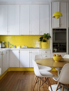 Yellow back splash with white cabinets... There is just something about this look