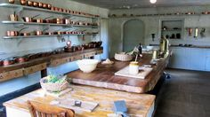 Ham House Kitchen with shelves full of copper cooking utensils.