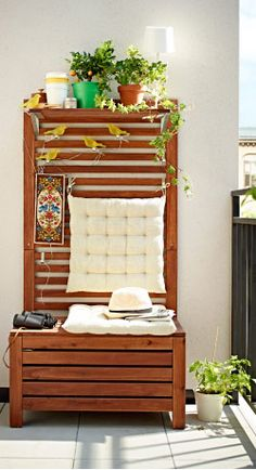 A storage bench with wall panel on the balcony -  ÄPPLARÖ  Bench w panel+ shelves, outdoor, brown