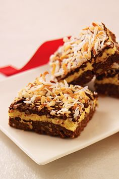 Layered Coconut-Chocolate Bars - Four layers work together in this delicious dessert: A walnutty crust is topped with a creamy center, a layer of chocolate and toasted coconut flakes. Yum!
